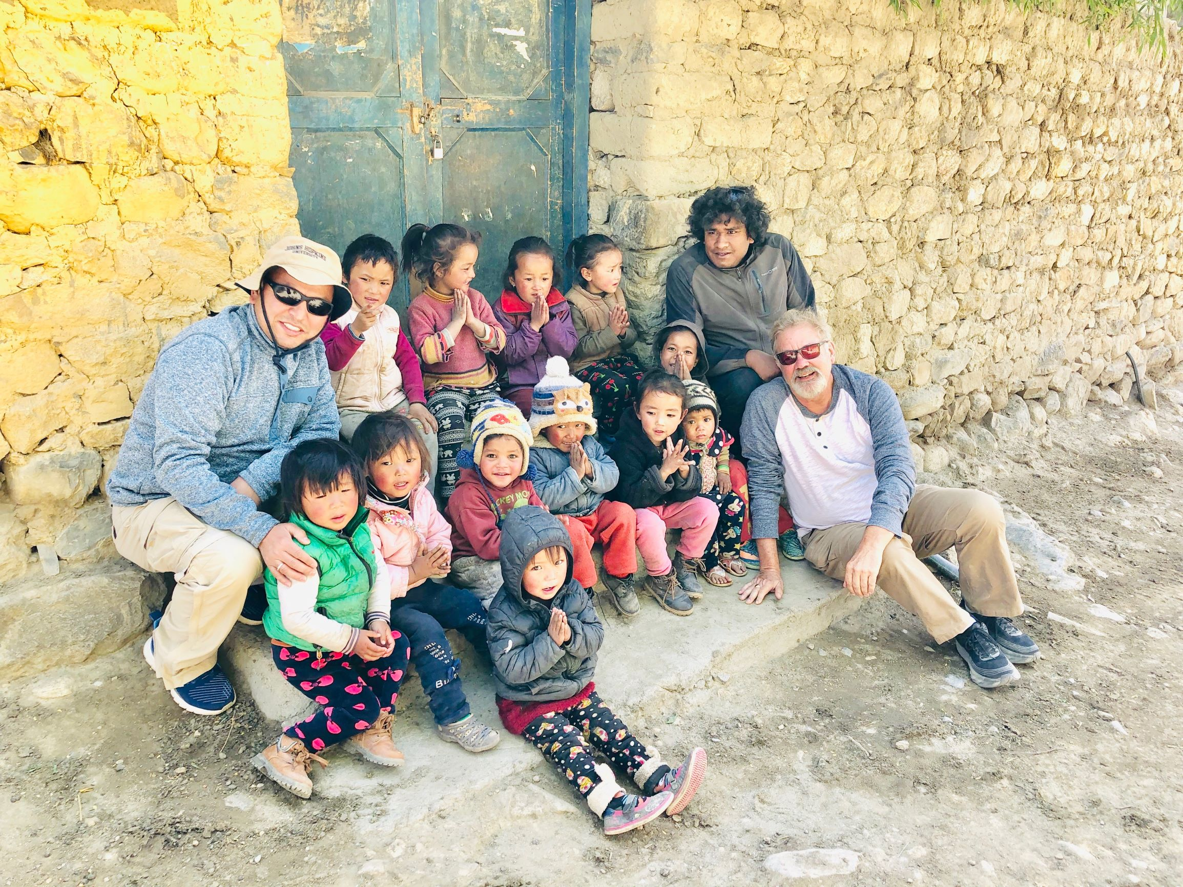 Dr. Mohan Dangi and Dr. Timothy Stearns with schoolchildren near the Tibet border.