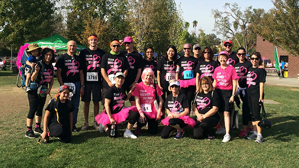 Dr. Jenna Kieckhaefer, family, friends and colleagues from the College of Social Sciences participate in the 2019 Komen Fresno MORE THAN PINK Walk on Oct. 12 at Fresno State.