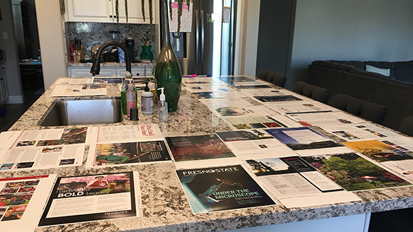 Magazine proofs arranged on a kitchen counter
