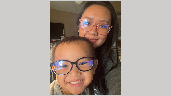 BoNhia Lee, communications specialist in University Communications, pictured with her son, Logan, 3.