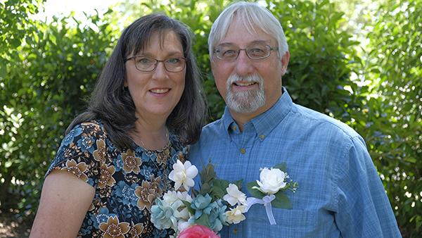 Lisa Boyles Bell, public information officer in University Communications, pictured with her husband.