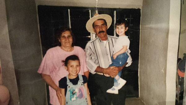 Fresno State communications specialist Selene Kinder is pictured as a child with her grandparents and her sister.