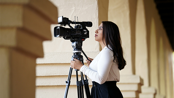 Fresno State alumna Gina Avalos sets up her camera during a day on the job as a multimedia journalist for KSBY TV in San Luis Obispo.