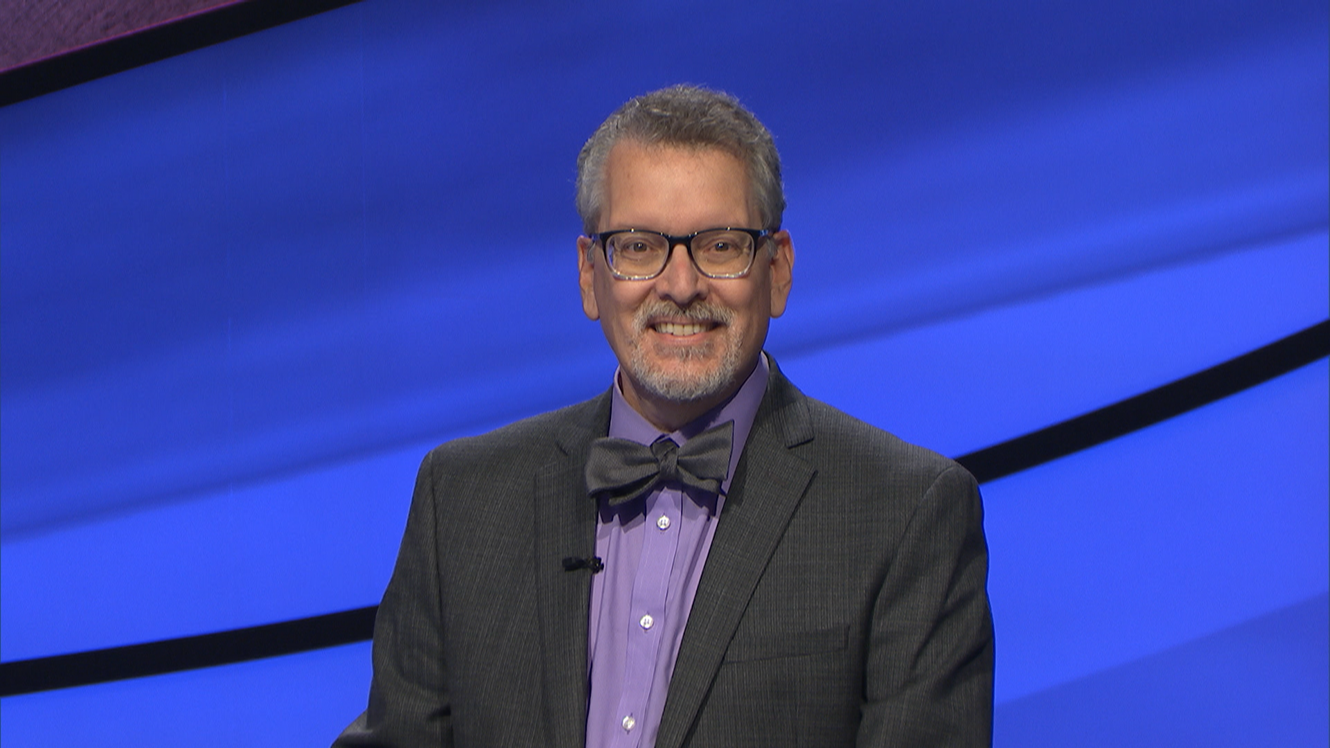 """Headshot of Dr. Frederick Nelson on one of the last taped episodes of """"Jeopardy!"""" with Alex Trebek."""