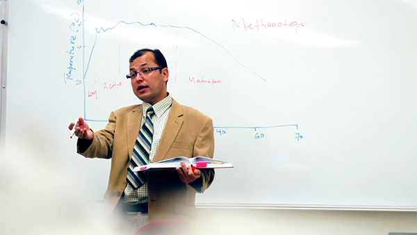 Dr. Mohan Dangi, professor in the Department of Geography and City and Regional Planning, teaches in a classroom.