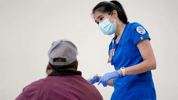 Fresno State nursing student speaks to a patient.