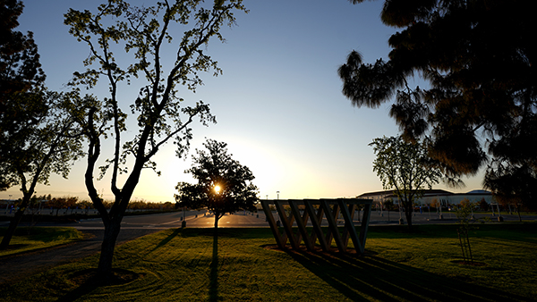 Sunset in front of the he Sweet Sixteen sculpture east of the Phebe Conley Art Building at Fresno State.