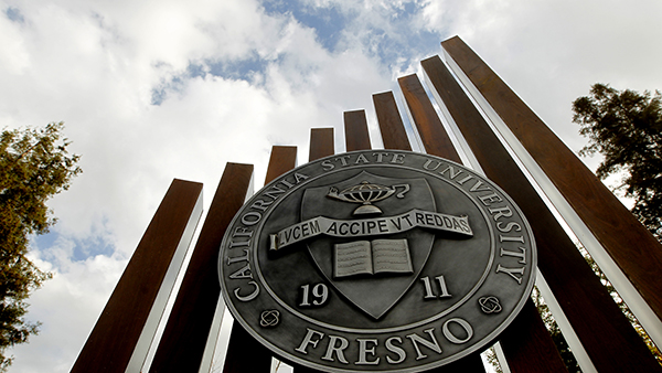 Fresno State medallion and statue.