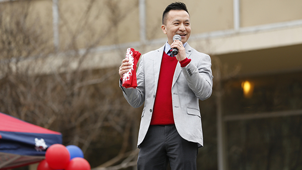 Phong Yang, director of Admissions and Recruitment, speaking into a microphone