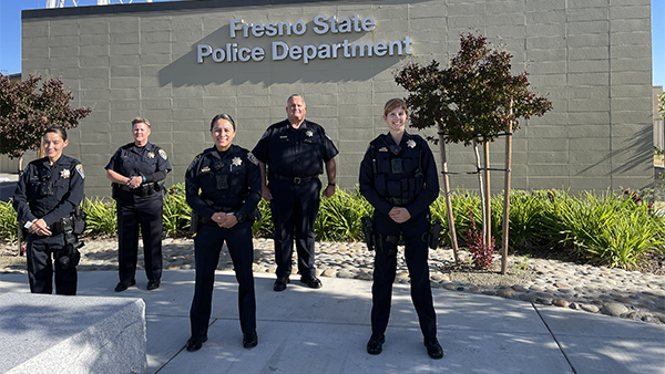 Fresno State Police Officers Yesenia Hernandez, Alma Hernandez and Abigayle Egger with Chief Jim Watson and Lt. Jennifer Curwick .