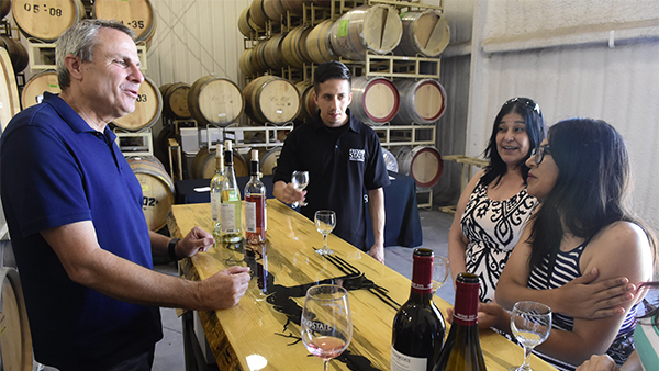 People chatting about wine at the Fresno State Winery.