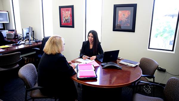Two women sitting in an office