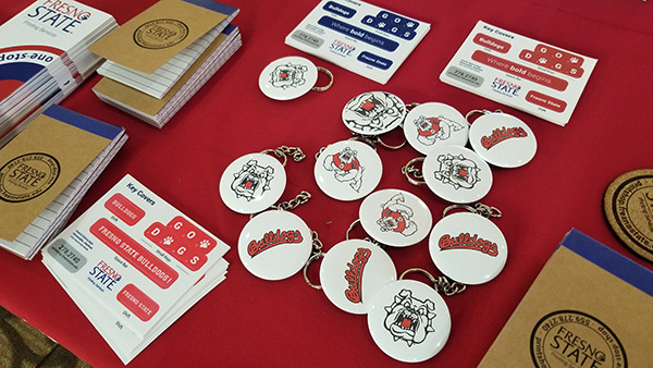 Buttons and notepads on a red tablecloth