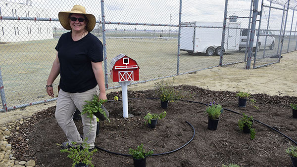Calliope Correia, instructional support technician, Horticulture Nursery at the Avenal State Prison teaching gardening