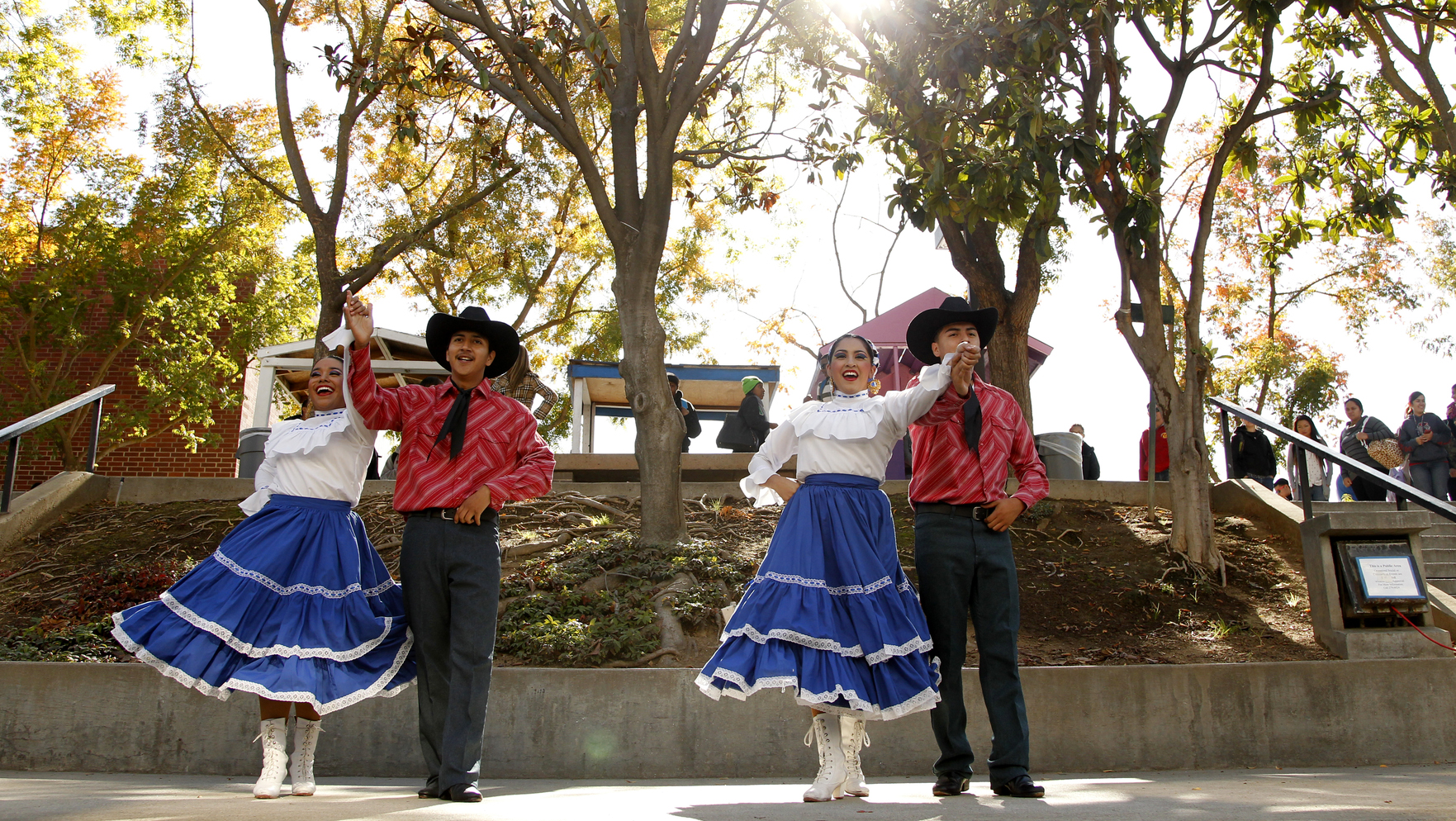 Hispanic dancers on stage in front of the food court.