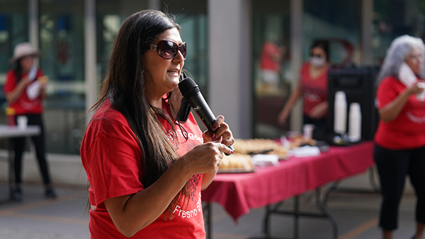 Belinda Munoz, chair of staff assembly at a campus event.